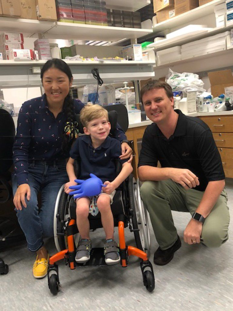 Will Woleben, 6, of McKinney visits with UT Southwestern Medical Center researchers Steven Gray and Qinglan Ling on Aug. 10, 2018. Gray's lab is developing a custom gene therapy that could help Will, who suffers from a rare, genetic illness called Leigh syndrome.