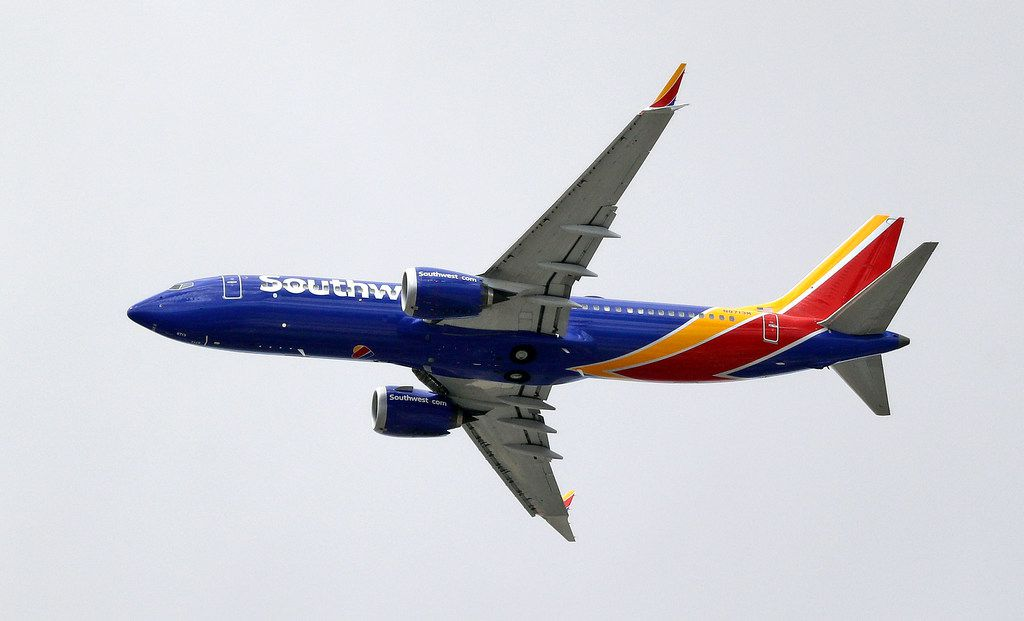 A Southwest Airlines Boeing 737 MAX 8 jet flies over Mesa, Ariz., en route to Phoenix's Sky Harbor International Airport Wednesday afternoon, March 13, 2019.