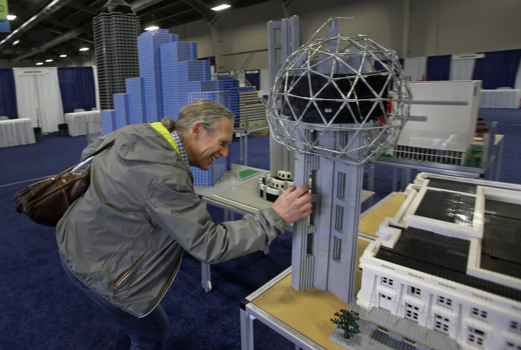 Trammell S. Crow examined a replica of downtown Dallas made out of Legos as he checked out preparations for his annual Earth Day Texas festival at Fair Park in April.