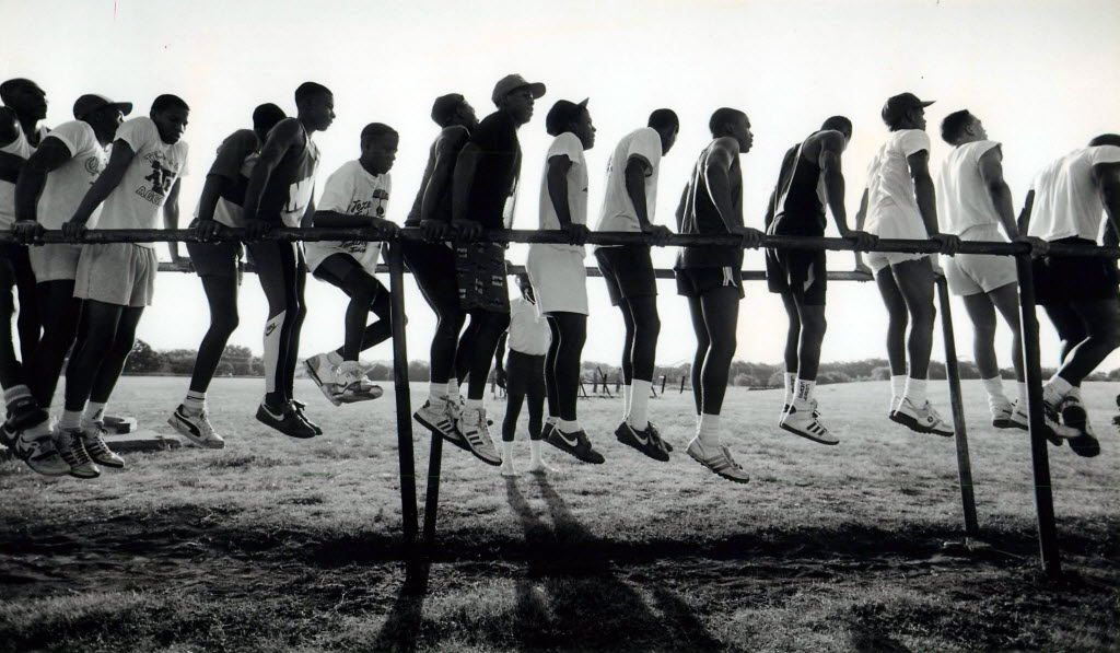 Carter players practiced calisthenics on the parallel bars. (File Photo/Staff)