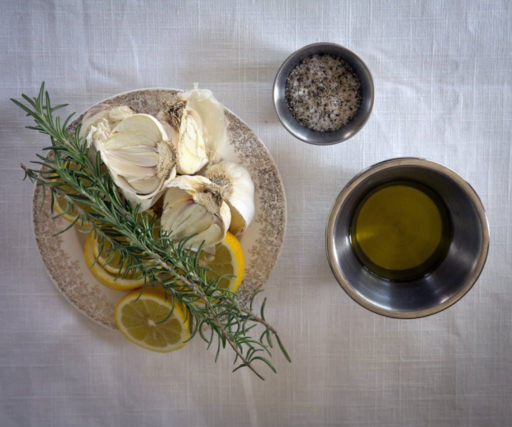 (Clockwise from left) Lemons, garlic and rosemary, a blend of spices, and olive oil to be used in Rebecca White's roasted chicken recipe Thursday, April 14, 2016 in Plano, Texas. (G.J. McCarthy/The Dallas Morning News)