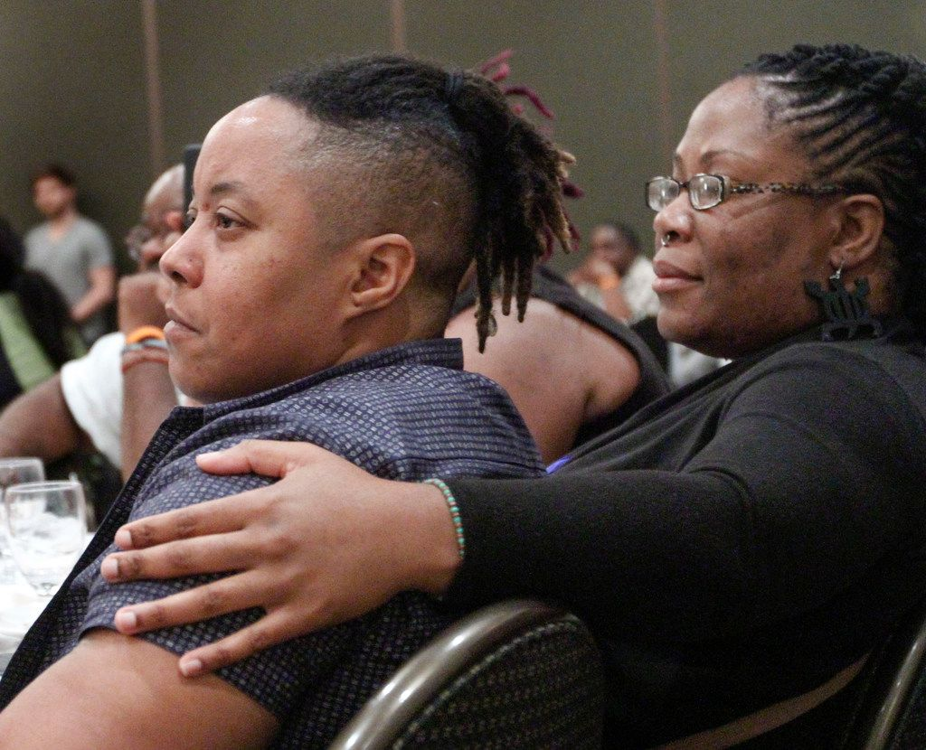 Partners Q Crawford and Teonia Burton listen to the keynote speaker at the Black Trans Advocacy Conference. They came from Florida to attend the conference.