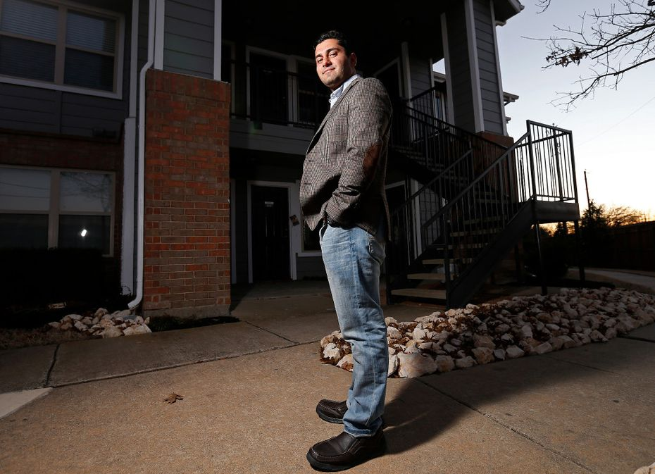 Ibrahim Yousif stands in front of his apartment in Plano, Texas on Sunday. He served for almost three years as an interpreter for the U.S. Army in Iraq. (Jae S. Lee/Staff Photographer)