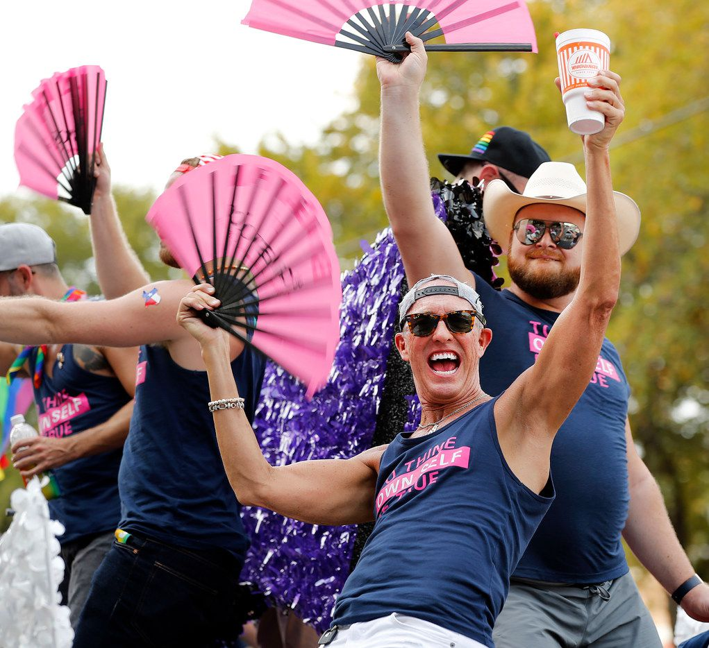 Men dance on a Black Tie Dinner, Inc. float during the Texas Freedom Parade.