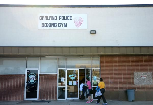 A family enters the Garland Police Boxing Gym for the after-school boxing program.