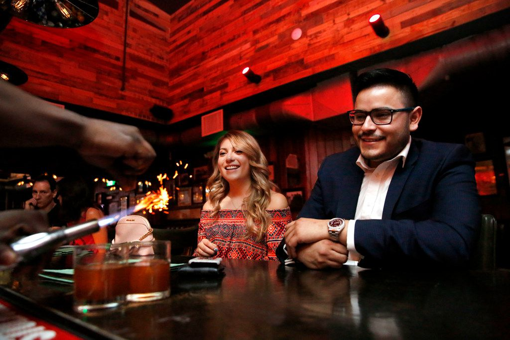 Ana Rangel and Marcos Guardado watch their cocktails get made at The Volstead Room speakeasy in Lewisville, Texas on Friday, March 16, 2018.