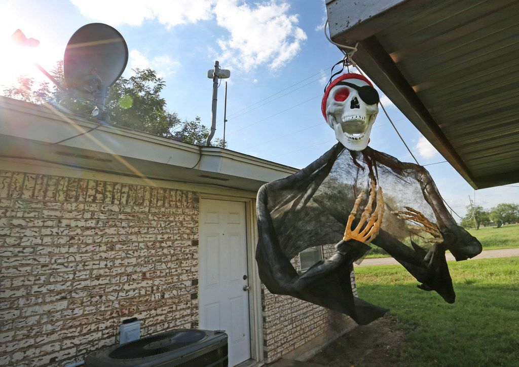 Halloween decorations flutter in the breeze at a home near downtown Moran, Texas, photographed on Thursday, October 5, 2017. (Louis DeLuca/The Dallas Morning News)
