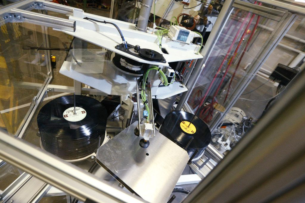 Finished records sit in stacks on the press at Hand Drawn Pressing in Addison, Texas.