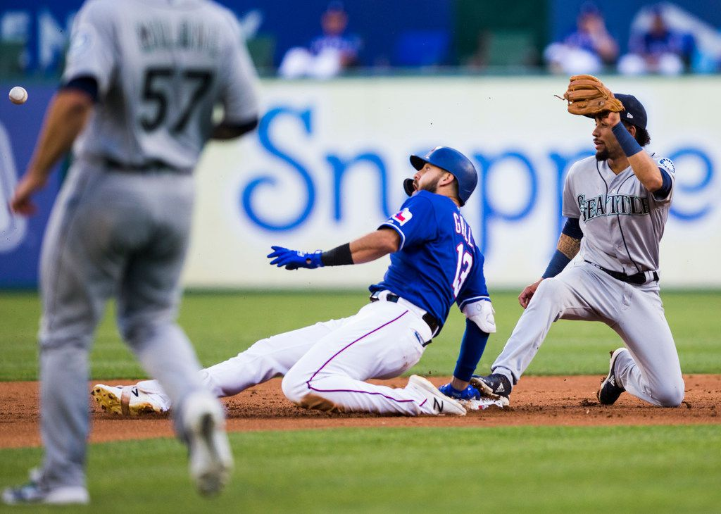 Texas Rangers center fielder Joey Gallo (13) is safe with a double after Seattle Mariners second baseman Shed Long (39) can't come up with a throw during the second inning of an MLB game between the Texas Rangers and the Seattle Mariners on Tuesday, May 21, 2019 at Globe Life Park in Arlington. (Ashley Landis/The Dallas Morning News)