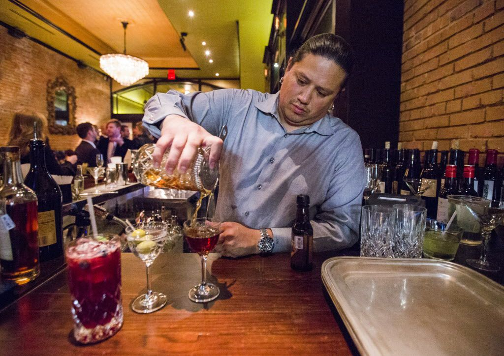 Co-owner Adam Salazar pours cocktails at The Mitchell, a restaurant and cocktail bar, on Thursday, February 12, 2015 in downtown Dallas, Texas.