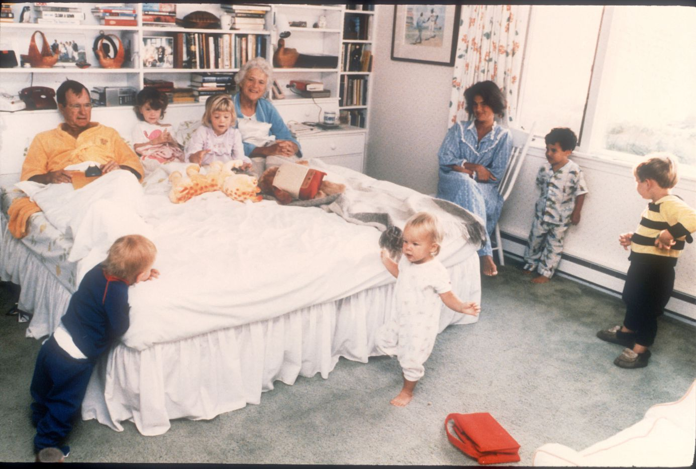George and Barbara Bush are joined in their bedroom by six of their grandchildren at the family retreat in Kennebunkport, Maine, in 1987. George H.W. was vice president at the time. The spontaneous moment, shot by George H.W. Bush's personal photographer for use in Life magazine, became an iconic photo of the Bush family.