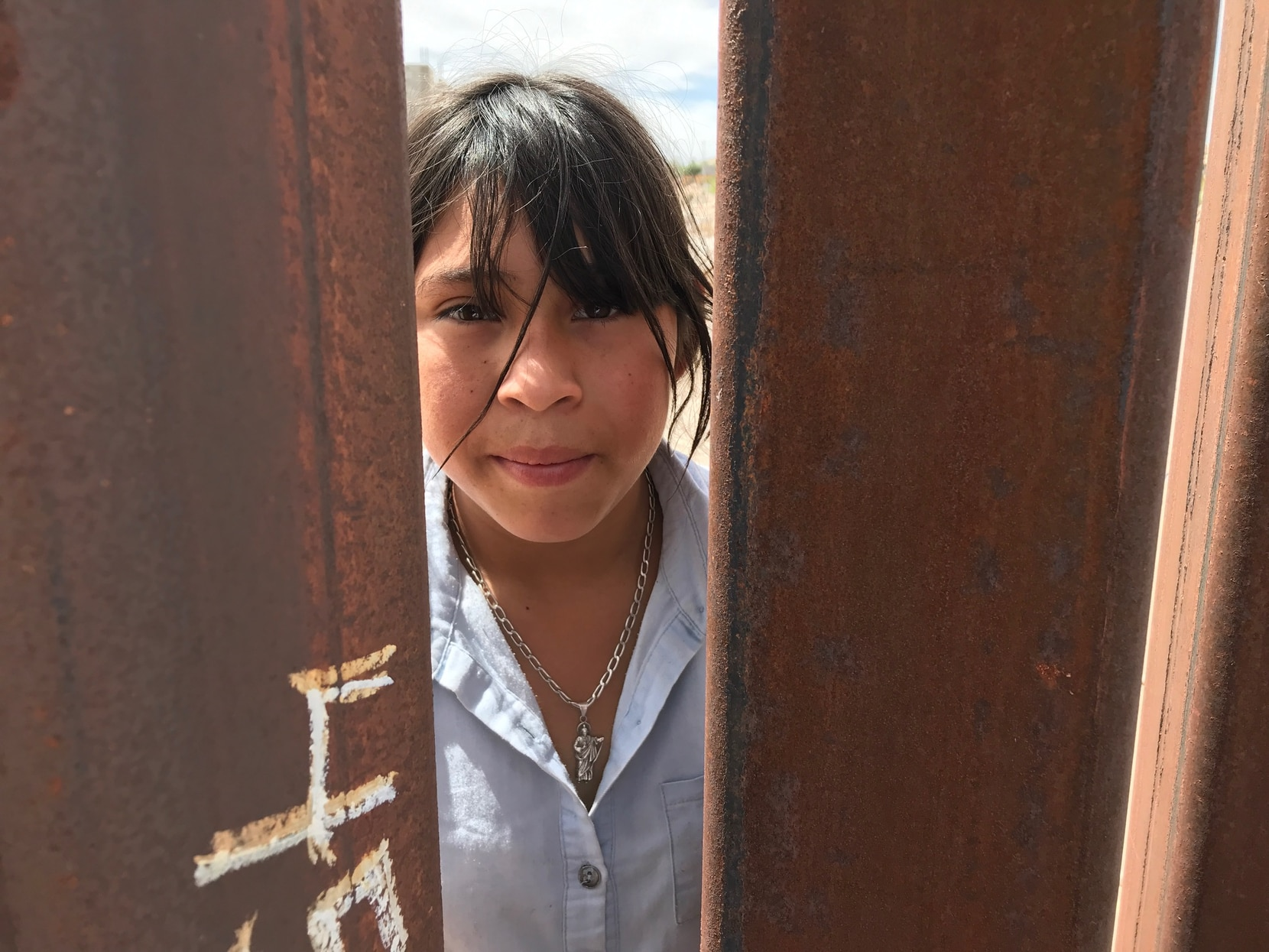 Michelle Aide Campos, 12, isn't happy with barriers that went up almost a year ago near her home in Anapra, Mexico. But, she added, the steel, rustic bollard fence is better than a concrete wall.