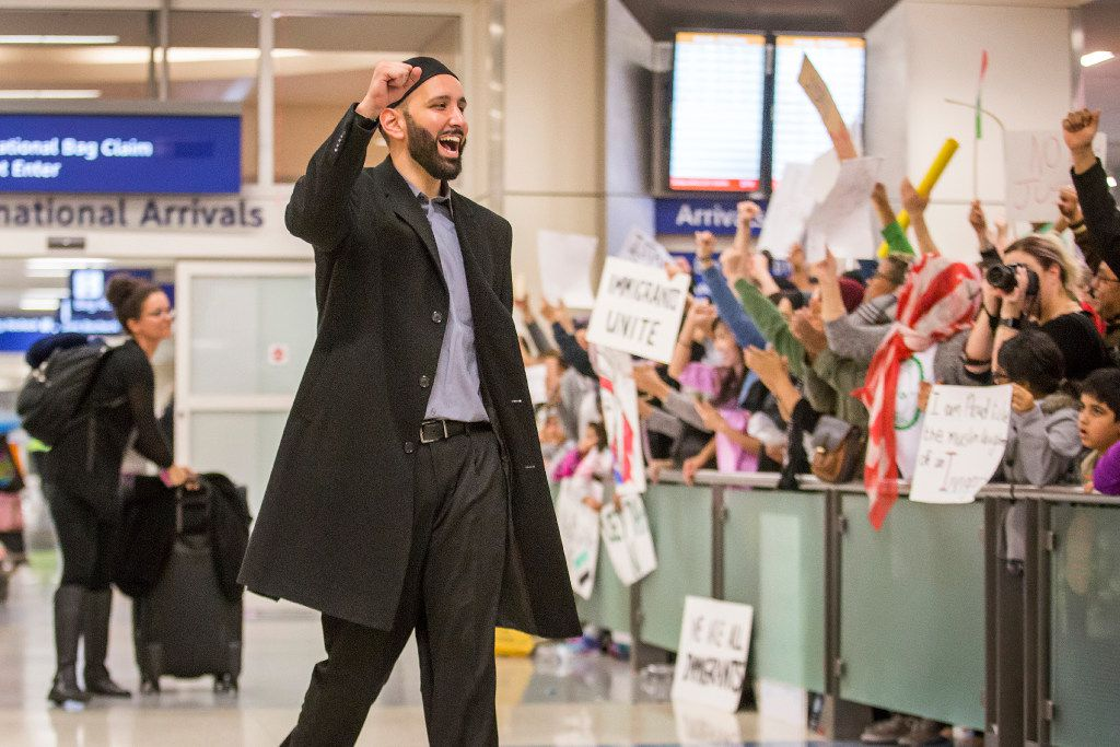 Imam Omar Suleiman celebrates with protestors at DFW International Airport who gathered in opposition to President Donald Trump's executive order barring certain travelers on Sunday, Jan. 29, 2017.  (Smiley N. Pool/The Dallas Morning News)