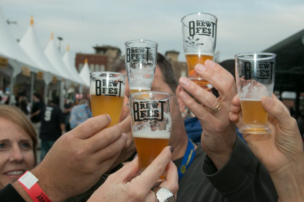 Drinkers cheers with beers at a previous Dallas Observer BrewFest.