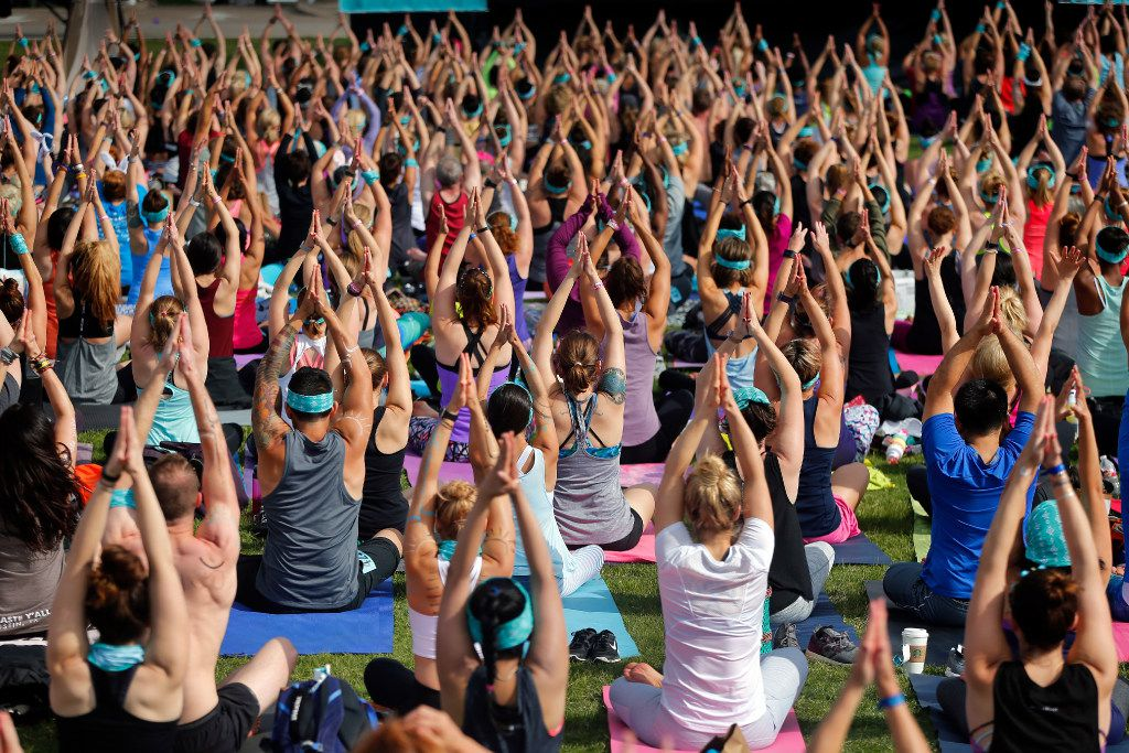 Yoga enthusiasts participate in a yoga and mediation session following in downtown Dallas.