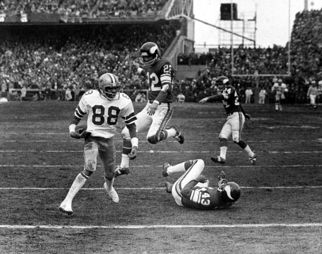 """Forty years ago today, Dallas Cowboys wide receiver Drew Pearson (88) catches Roger Staubach's """"Hail Mary"""" during the 1975 NFC Divisional Playoff game against the Minnesota Vikings. Since then, the phrase """"Hail Mary"""" has become popular not only in football terminology but also in pop culture, adding a new phrase to our urban language. [ AP file photo ]"""
