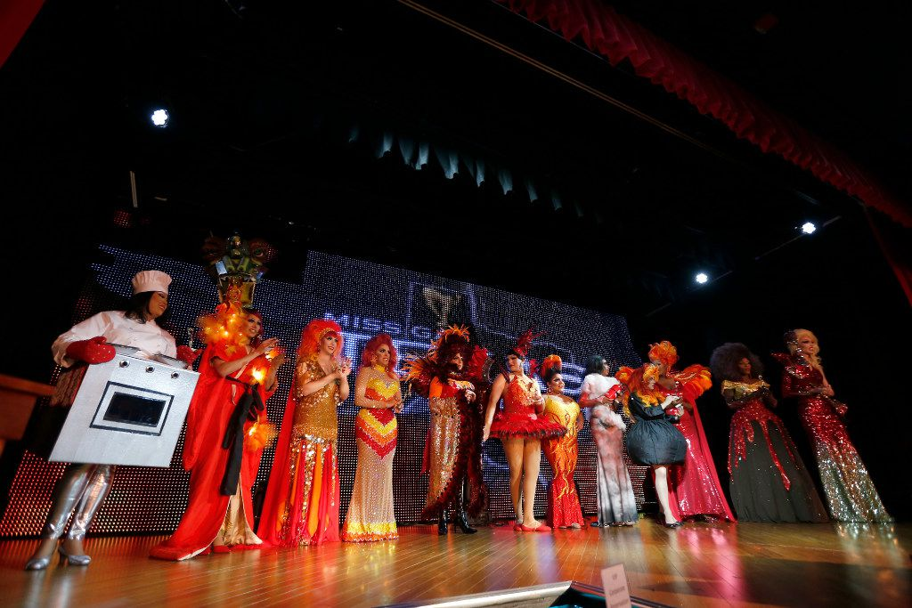To compete in the presentation category, contestants interpret the theme of Queens on Fire in their outfits, leading to a bevy of red, orange and yellow sequins and feathers -- but also an oven, a fire-breathing dragon and a fire extinguisher.