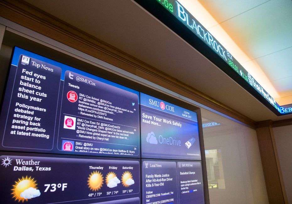 Screens show news and stock updates inside The Kitt Investing and Trading Center at the Cox School of Business on Thursday, April 6, 2017 on the Southern Methodist University campus in Dallas.  (Ashley Landis/Staff Photographer)
