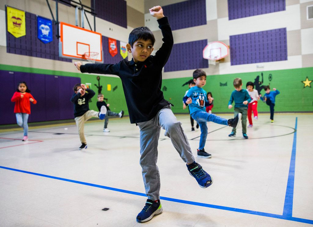 Fayz Ahmed and other kindergarten students participate in a martial arts class at Pink Elementary in Frisco.