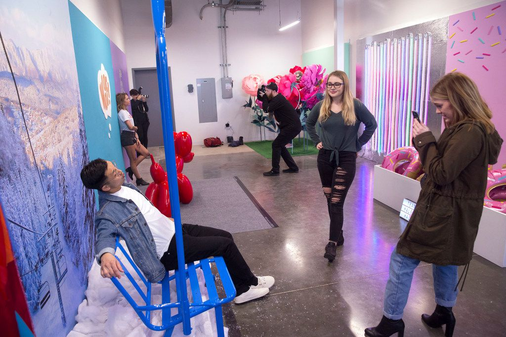 Hammer Vong, left, of Grand Prairie, Texas poses as his friend, Kayla Stoetzel, right, of Arlington, Texas takes his photo as Hunter Deane (center) looks on inside Snap 151, a pop-up installation, in Fort Worth, Texas on Thursday, January 17, 2019.The pop-up runs from 10 a.m.-10 p.m. until January 27. (Daniel Carde/The Dallas Morning News)