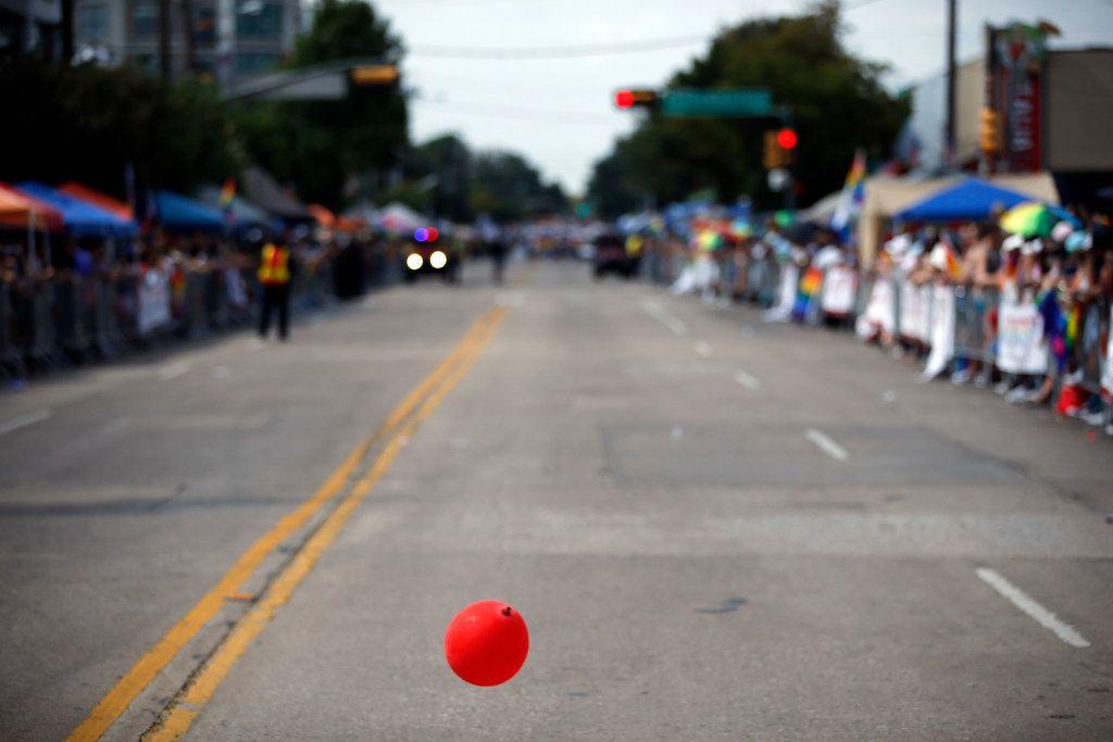 A lone balloon bounces along Cedar Springs Rd. before the Texas Freedom Parade begins, Sunday, September 17, 2017.