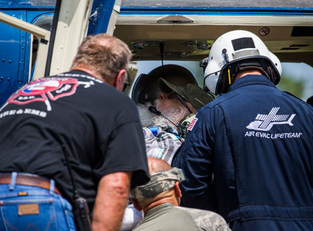 Hendrix Parks, center, is treated inside a medical helicopter by Lumberton EMS and firefighters in front of the Lumberton Central Fire Department on Friday, September 1, 2017 in Lumberton, Texas. Parks was in need of dialysis. Six medical helicopters landed in front of the station on Country Lane Drive to transport critical patients to hospitals in other cities. Lumberton is isolated because of flood waters from Hurricane Harvey.