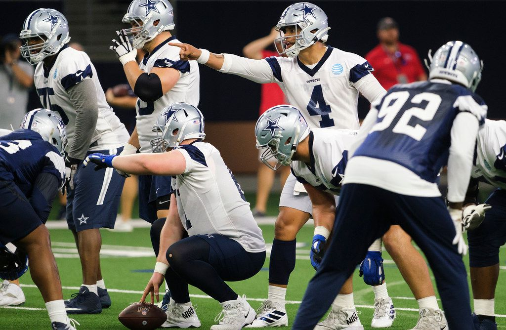 Dallas Cowboys quarterback Dak Prescott (4) lines up behind center Adam Redmond (61) during a team OTA practice at The Star on Wednesday, June 5, 2019, in Frisco. (Smiley N. Pool/The Dallas Morning News)