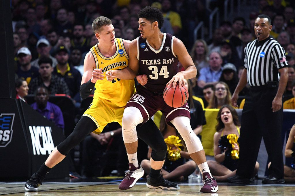 LOS ANGELES, CA - MARCH 22: Tyler Davis #34 of the Texas A&M Aggies is defended by Moritz Wagner #13 of the Michigan Wolverines during the first half in the 2018 NCAA Men's Basketball Tournament West Regional at Staples Center on March 22, 2018 in Los Angeles, California.  (Photo by Harry How/Getty Images)