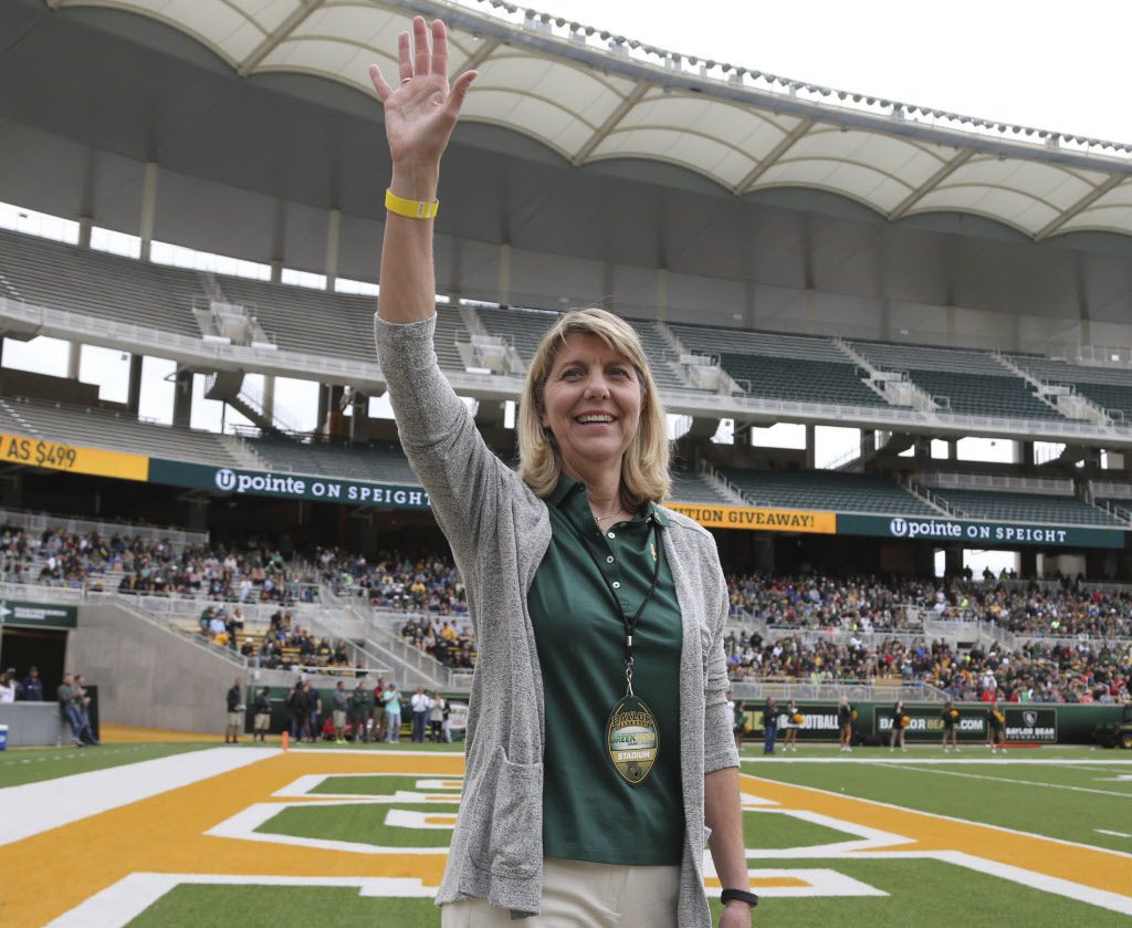 Baylor's new president, Linda Livingstone, is making some smart staffing changes. Above, she waves to the fans as she was introduced during the first half of the football team's spring Green and Gold game in April.