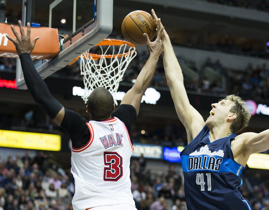 FILE - Mavericks forward Dirk Nowitzki (41) blocks a shot by Heat guard Dwyane Wade (3) during the second half of a game at American Airlines Center on Wednesday, Feb. 3, 2016, in Dallas. (Smiley N. Pool/The Dallas Morning News)