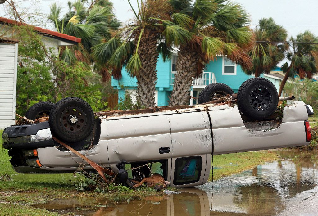 A truck is flipped over after Hurricane Harvey landed in the Coast Bend area on Saturday, Aug. 26, 2017, in Port Aransas, Texas. The National Hurricane Center has downgraded Harvey from a Category 1 hurricane to a tropical storm. Harvey came ashore Friday along the Texas Gulf Coast as a Category 4 storm with 130 mph winds, the most powerful hurricane to hit the U.S. in more than a decade.