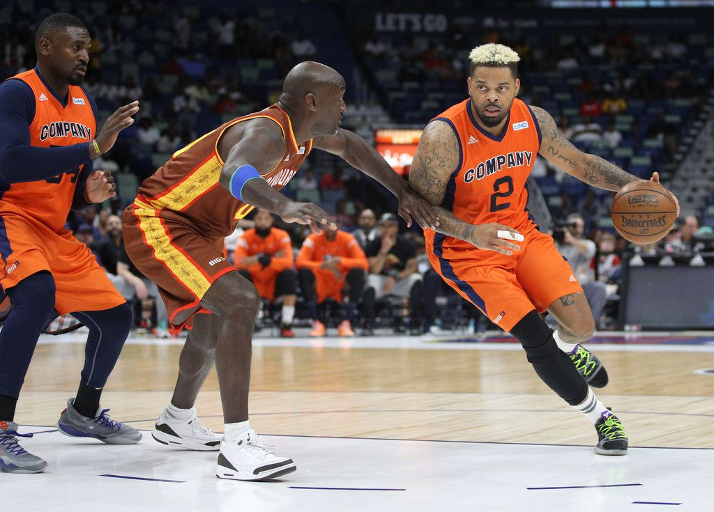 Andre Emmett #2 of 3's Company dribbles the ball as Dion Glover #00 of Bivouac defends  during the BIG3 Playoffs at Smoothie King Center on August 25, 2019 in New Orleans.