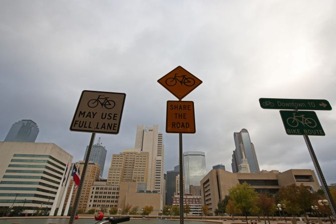 Bike signs were temporarily erected at Dallas City Hall for a press conference Wednesday about new shared bike lanes.