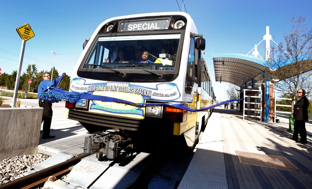 DART rail operator Antaeus Chandler drove through the blue ribbon stretched across the tracks at the newly completed UNT Dallas Station in southeast Oak Cliff on Thursday.