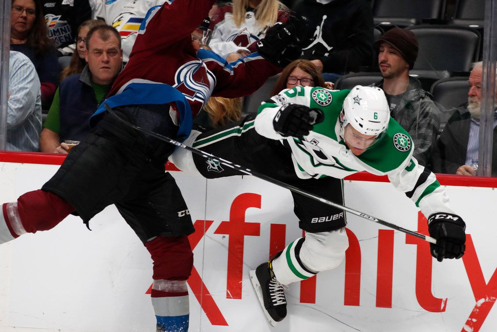 Colorado Avalanche left wing Gabriel Bourque, left, collides with Dallas Stars defenseman Julius Honka, of Finland, as they battle for control of the puck along the boards in the first period of an NHL hockey game Tuesday, Oct. 24, 2017, in Denver. (AP Photo/David Zalubowski)
