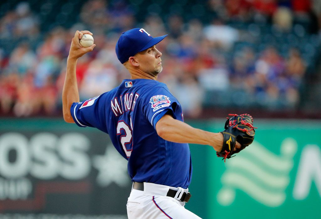 Texas Rangers' Mike Minor throws to a Minnesota Twins batter during the first inning of a baseball game in Arlington, Texas, Friday, Aug. 16, 2019. (AP Photo/Tony Gutierrez)