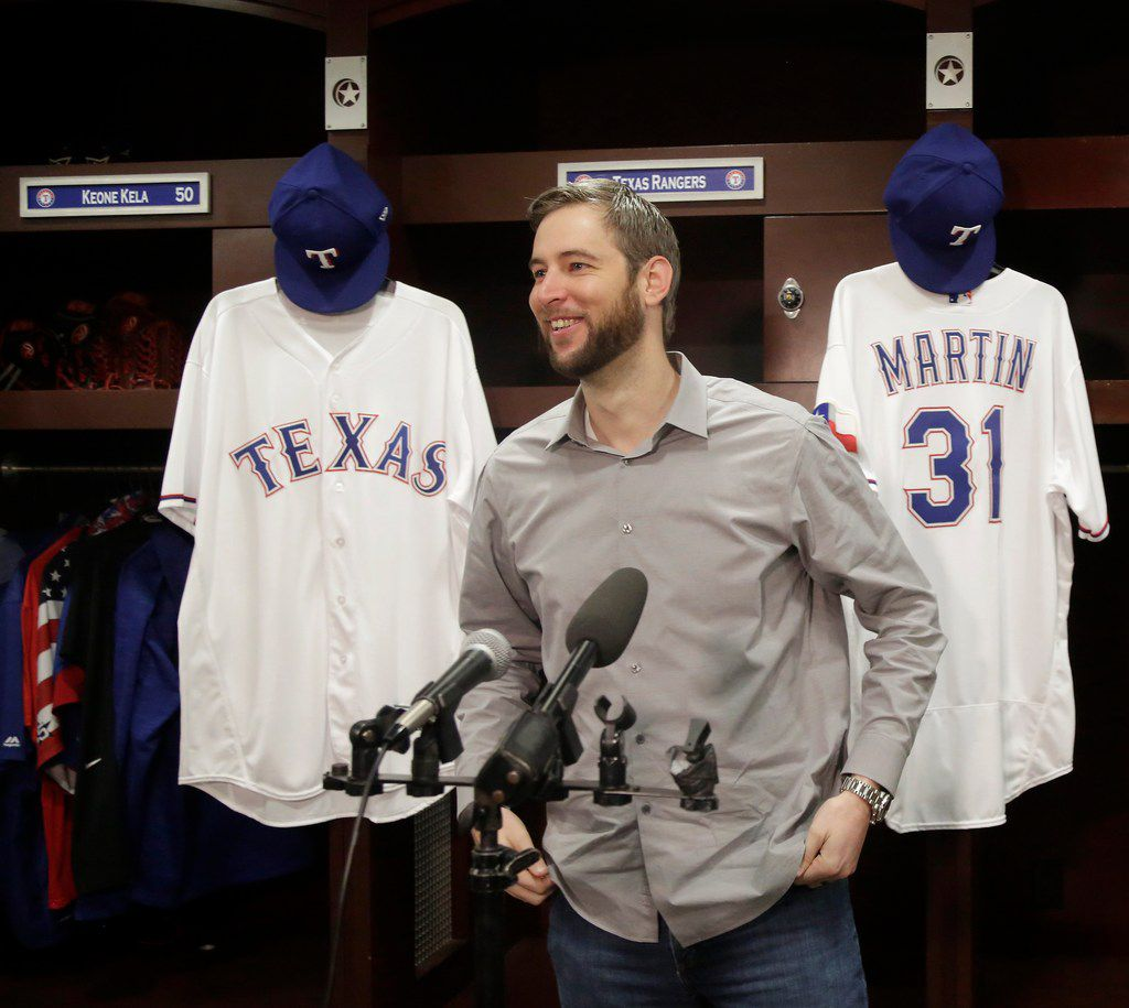 Free agent right-handed pitcher Chris Martin talks with area media after signing to a two-year contract with the Texas Rangers during a press conference at Globe Life Park in Arlington, Texas on Friday, Dec. 15, 2017.  ORG XMIT: B7311530009Z.1