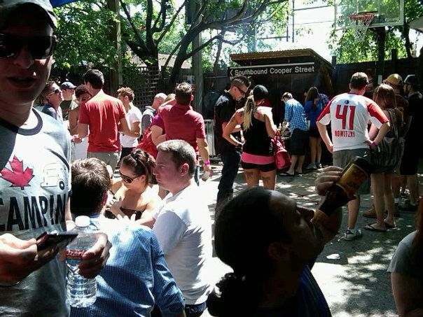 Crowds gather on the basketball court during 'Suck Fest,' a Cajun crawfish boil at the Grapevine Bar.
