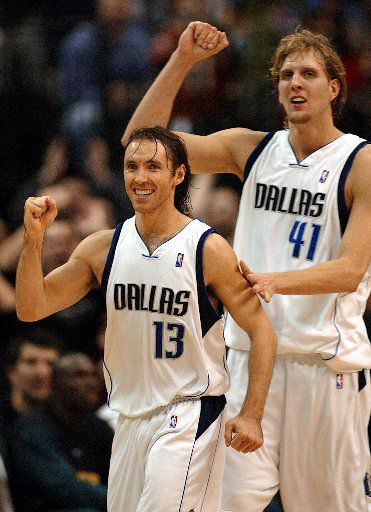 Steve Nash (L) and Dirk Nowitzki (R) of the Dallas Mavericks react to their come-from-behind win over the Seattle SuperSonics at American Airlines Center in Dallas, Texas, 23 November 2002..   AFP PHOTO/Paul BUCK