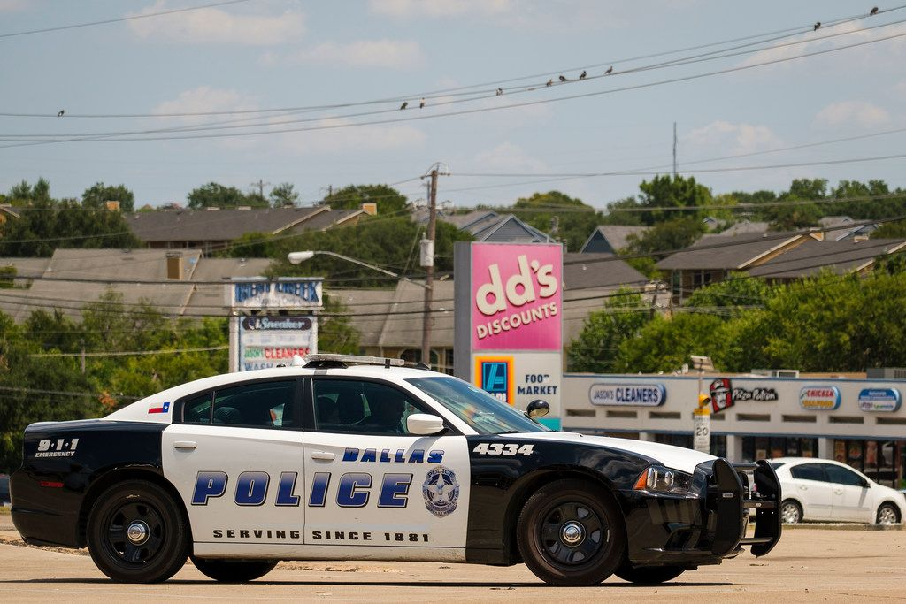 A Dallas Police vehicle sits in one of the parking lots at the Forest-Audelia intersection.