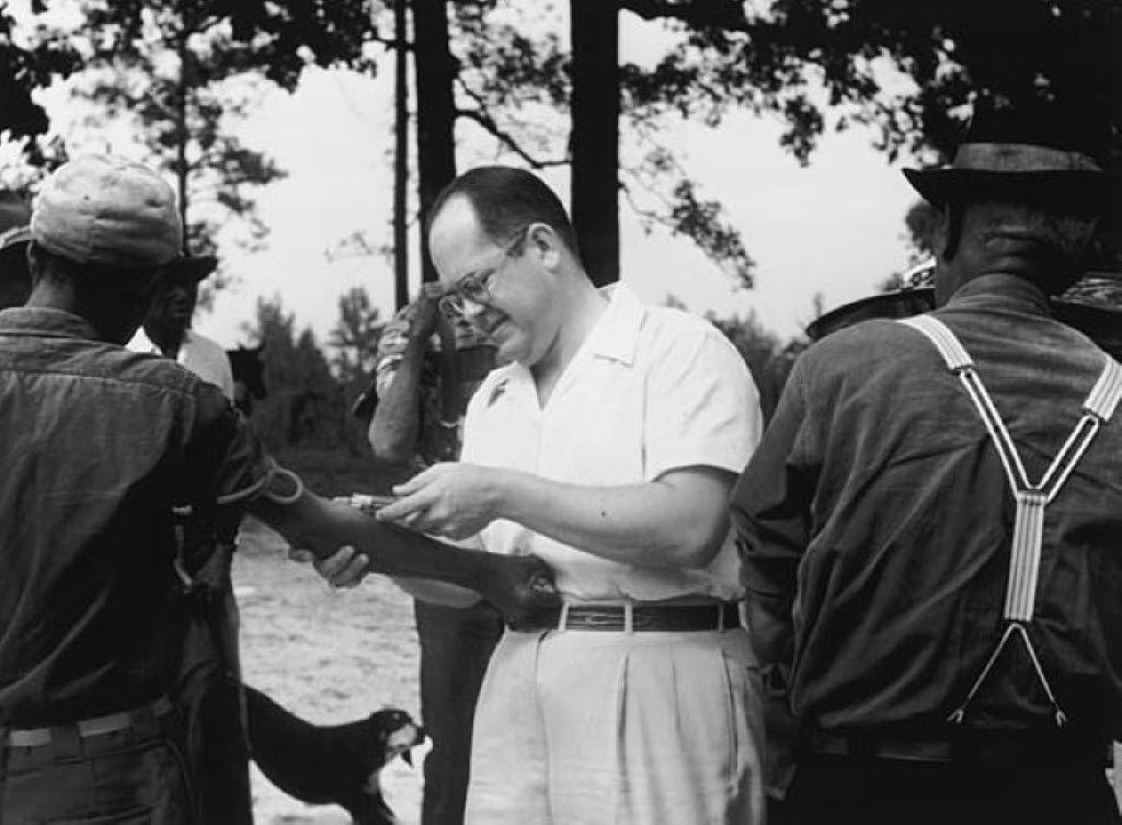 In an undated handout photo, a doctor injects a patient as part of the Tuskegee syphilis study, in which U.S. government researchers followed African-American men infected with syphilis and didn't treat them so that they could see the disease take its course. A new paper argues the effects of the study on public trust were so severe that it led older African-American men to avoid care, leading to a decrease in life expectancy of 1.4 years. (Handout via The New York Times) -- NO SALES; FOR EDITORIAL USE ONLY WITH TUSKEGEE SYPHILIS STUDY BY AARON E. CARROLL FOR JUNE 18, 2016. ALL OTHER USE PROHIBITED. --