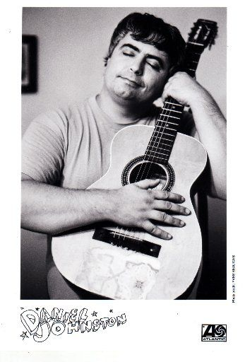 Daniel Johnston poses with his guitar in a promotional material for Atlantic Records.