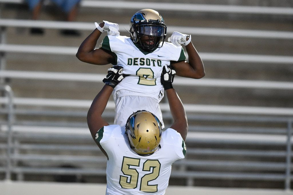 DeSoto senior wide receiver Jamal Brown (2) scores a touchdown and celebrates with DeSoto junior offensive lineman Joshua Jynes (52) at C.H. Collins Athletic Complex, Thursday, September 7, 2017, in Denton, Texas, Jeff Woo/DRC