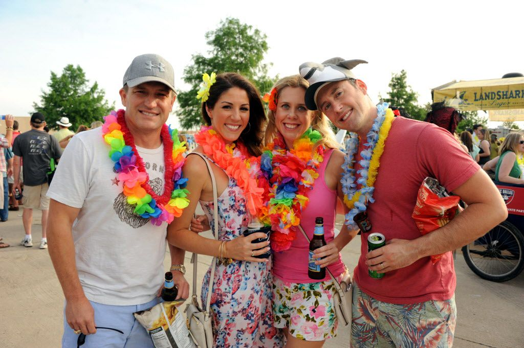 Fans decked out in Buffett attire enjoy the day at the Jimmy Buffett tailgate party at Toyota Stadium in Frisco, TX on May 30, 2015.