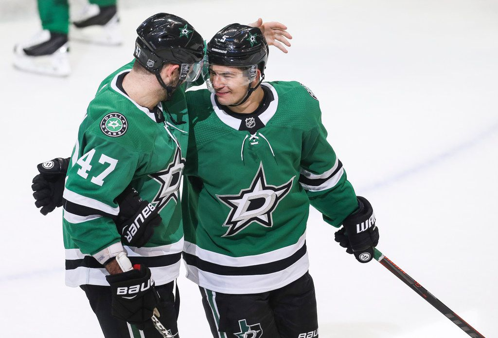Dallas Stars defenseman Connor Carrick (5) celebrates a win with right wing Alexander Radulov (47) during the second period of a game between the Dallas Stars and the Winnipeg Jets on Saturday, Oct. 6, 2018 at American Airlines Center in Dallas. (Ryan Michalesko/The Dallas Morning News)
