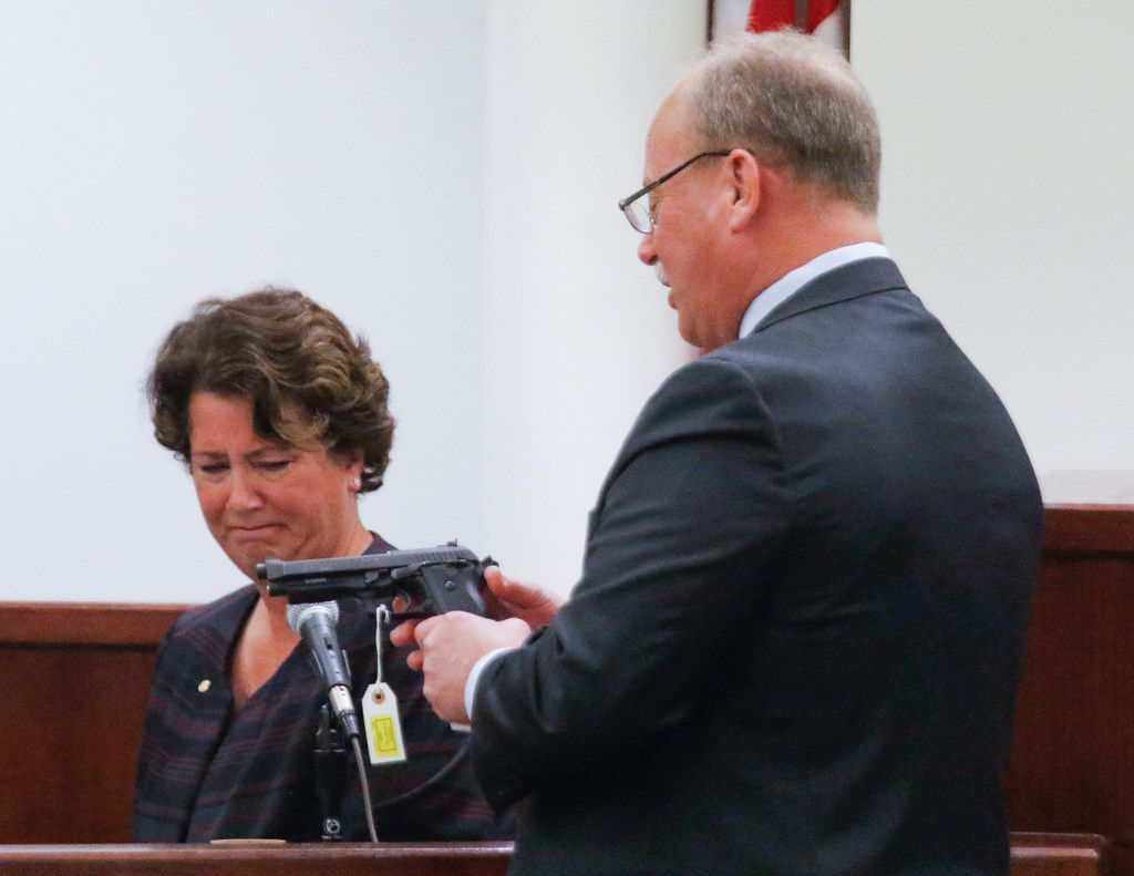 Jamie Becker, (left) a firearms expert with the Tarrant County Medical Examiner's Office, listens as defense attorney J. Warren St. John holds a handgun at the trial of Kenneth Martin held at the Tim Curry Criminal Justice Center in Fort Worth on April 23, 2018. Martin admitted to the killing his estranged wife, Linda Martin, at a stoplight in Southlake on May 31, 2016. This is the handgun recovered at the scene.