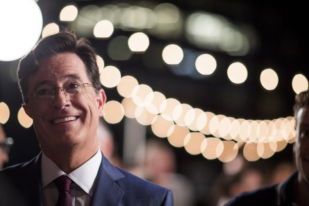"""Steven Colbert mingles with his staff as they film a segment for the opening credits of  """"The Late Show"""" on the roof of the Ed Sullivan Theater in New York."""