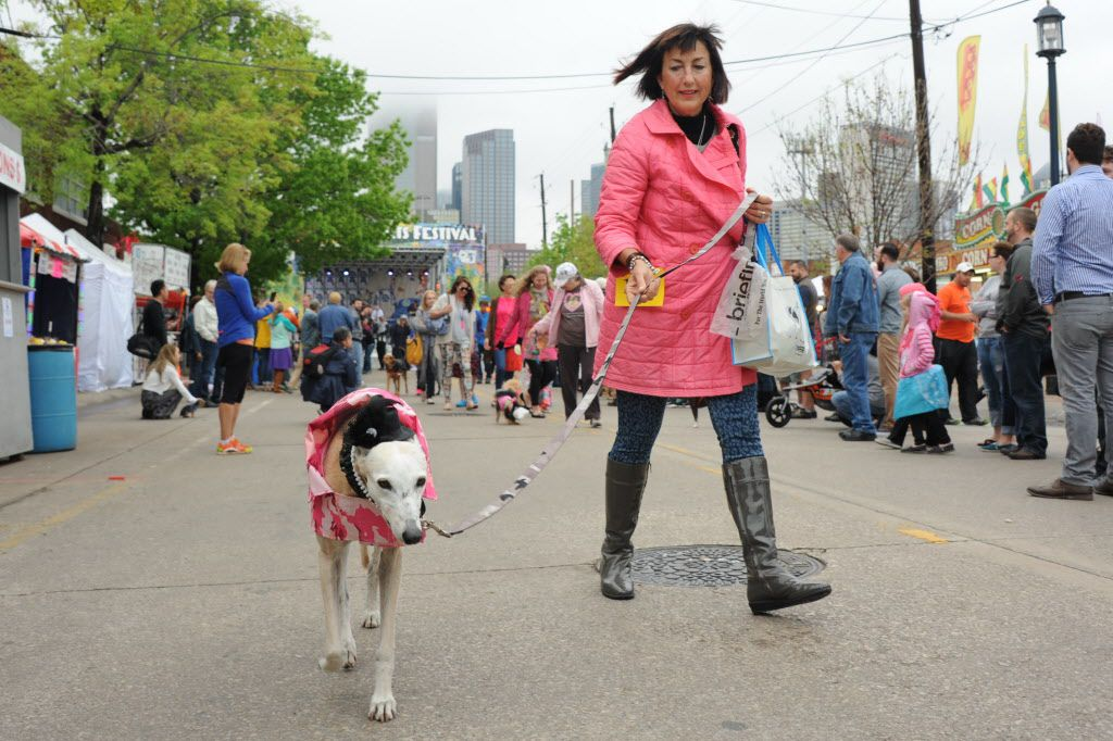 A matching dog and owner walk in the annual pet parade at the Deep Ellum Arts Festival.