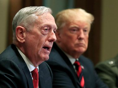 In this Oct. 23, 2018 file photo, Defense Secretary Jim Mattis speaks beside President Donald Trump, during a briefing with senior military leaders in the Cabinet Room at the White House in Washington. In Trump's America, is anyone listening to the conservative wise men who damn him with faint, coded criticism? (AP Photo/Manuel Balce Ceneta, File)