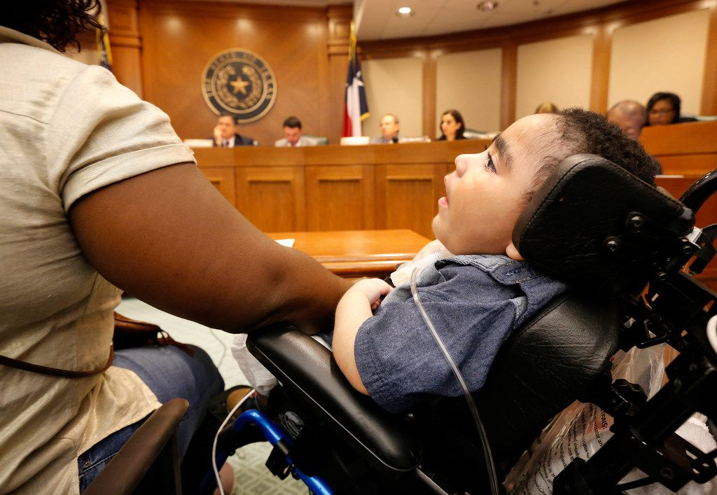 Medically fragile 3 yr-old  D'ashon Morris sits alongside his mother Linda Badawo of Mesquite, Texas as she testifies at a Texas House Committee on Human Services meeting that discussed recent information reported by The Dallas Morning News regarding Medicaid managed care and the Health and Human Services Commission.